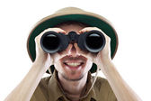 Happy explorer looking through binoculars — Stok fotoğraf