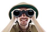 Happy explorer looking through binoculars — Stock Photo