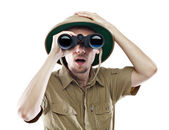 Amazed explorer looking through binoculars — Stock Photo