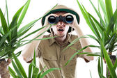 Explorer looking through binoculars — Stock Photo