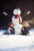 Tea time with a snowman — Stock Photo