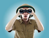 Surprised explorer looking through binoculars — Stock Photo