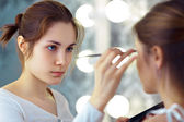 Make-up artist applying eyeshadows — Stock Photo