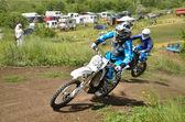 Motocross two racer turns — Stock Photo