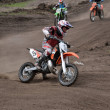 Stock Photo: Departure with acceleration out of left-turn MX racer