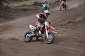 Departure with acceleration out of left-turn MX racer — Stock Photo