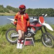 A girl and a motorcycle MX by Lake — Stock Photo