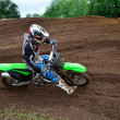 MX rider turns on a dirt hill — Foto de Stock