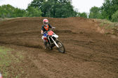 MX racer on a motorbike accelerating — Stock Photo