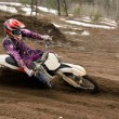 Stock Photo: Motocross rider turns point-blank of sand