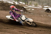 Motocross rider turns point-blank of sand — Stock Photo