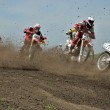 Start parts the motocross group of riders — Stock Photo #13851013