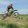 MX rider flies through the air — Stock Photo #14046668