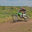MX rider on the bike jumps from a hill — Stock Photo #14046671