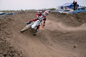 Motocross racer veering with large slope — Stock Photo