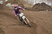 Motocross party rides standing cornering the furrow — Stock Photo