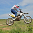 Motocross rider on a motorcycle in the air — Stock Photo