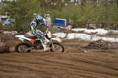 MX rider leaves the track grooves — Stock Photo