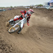 Motocross rider veering point-blank of clay — Stock Photo #14375309