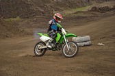 Motocross rider girl on a bend of the track MX — Stock Photo