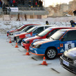 Cars at start of competition on ice track — Stock Photo #14400327