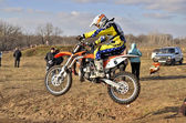 Saltation on a motorcycle motocross rider, on the sandy hills ro — Stock Photo