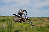 Extreme jump motocross racer by motorcycle — Stock Photo
