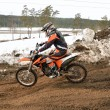 Motocross racer rides in descent on rear wheel — Stock Photo #16858253