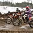 Two participants motocross compete in lifting mountains — Stock Photo #16858261