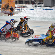 Three riders ice speedway compete on corner entry — Stock Photo