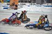 Three riders ice speedway compete on corner entry — Stock Photo