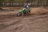MX rider turns point-blank of sand — Stock Photo