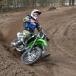 MX racer on a motorcycle in the reversal sandy track — Stock Photo