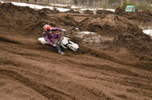 MX racer, with a large slope in gritty point-blank rotates on th — Stock Photo