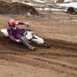Stock Photo: MX racing driver at turning in sandy ruts