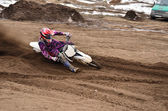 MX racing driver at the turning in the sandy ruts — Stock Photo