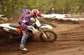 Rider stuck in deep ruts turning the sandy MX track — Stock Photo