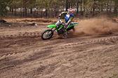 MX rider turns point-blank of sand — Stock Photo