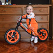 Stock Photo: Small child sits on balance bike