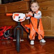 Stock Photo: Child grasps steering wheel balance bike is worth