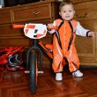 Stock Photo: Small child stands near balance bike