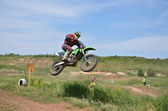 MX rider on the motorbike takes off from the hill — Stock Photo