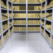 Foto Stock: Shelves with gold