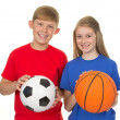 Boy and girl with sports balls — Stock Photo #12206645