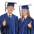 Thumbs up child graduate — Stock Photo #12255521