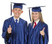 Thumbs up child graduate — Stock Photo