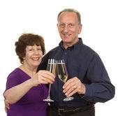 Elderly couple with champagne — Foto Stock