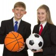 Two Happy Students Holding Ball — Stock Photo #25762821
