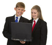 Two Happy Students Using Laptop — Stock Photo