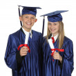 Two Happy Students Holding Degree — Stock Photo #25950955